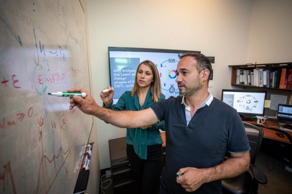 Berkeley Lab scientists Tijana Radivojevic (left) and Hector Garcia Martin working on mechanistic and statistical modeling. Credit: Thor Swift/Berkeley Lab