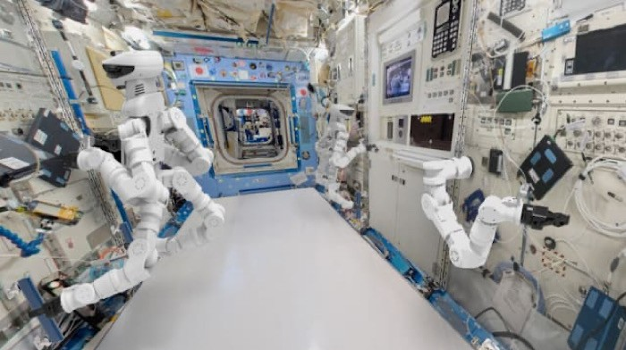 An artist's rendering brings to life GITAI's vision of robots working on the International Space Station. Source: GITAI