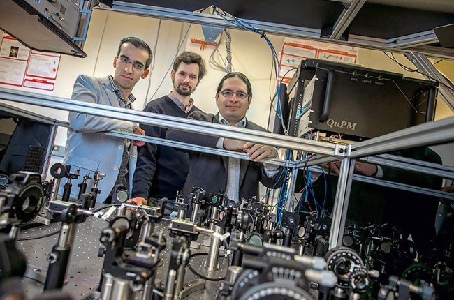 Eden Figueroa (right) has worked for several years on technology that would extend the distance that quantum particles can travel and still be entangled. (Credit: Stony Brook University)